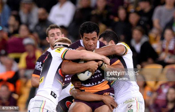 Tautau Moga of the Broncos takes on the defence during the round nine NRL match between the Brisbane Broncos and the Penrith Panthers at Suncorp...