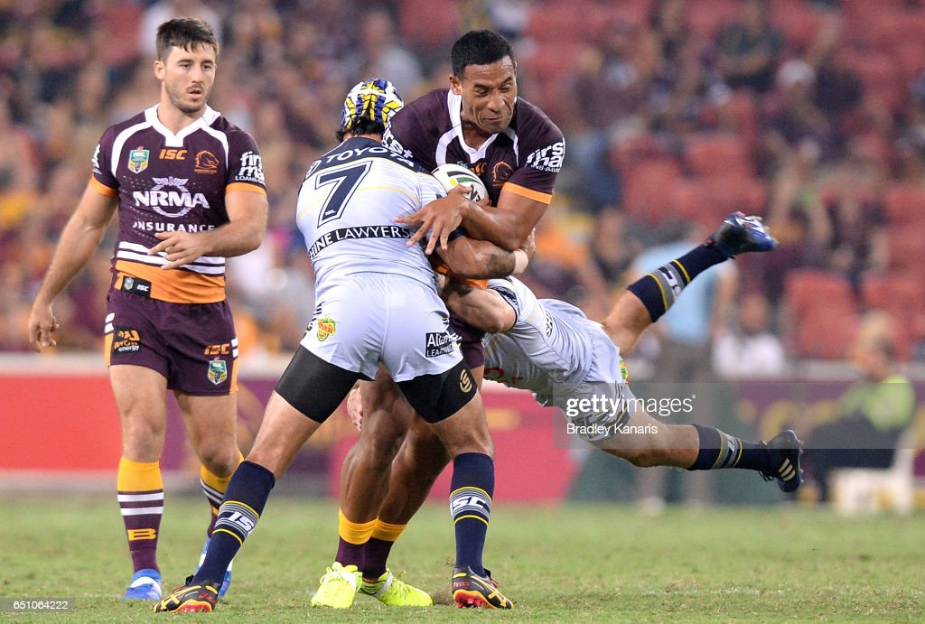 Tautau Moga of the Broncos takes on the defence during the round two NRL match between the Brisbane Broncos and the North Queensland Cowboys at Suncorp Stadium on March 10, 2017 in Brisbane, Australia.