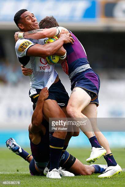 Tautau Moga of the Cowboys is tackled during the match between the Storm and the Cowboys in the 2015 Auckland Nines at Eden Park on January 31, 2015...