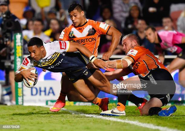 Tautau Moga of the Cowboys scores a try during the round 22 NRL match between the North Queensland Cowboys and the Wests Tigers at 1300SMILES Stadium...