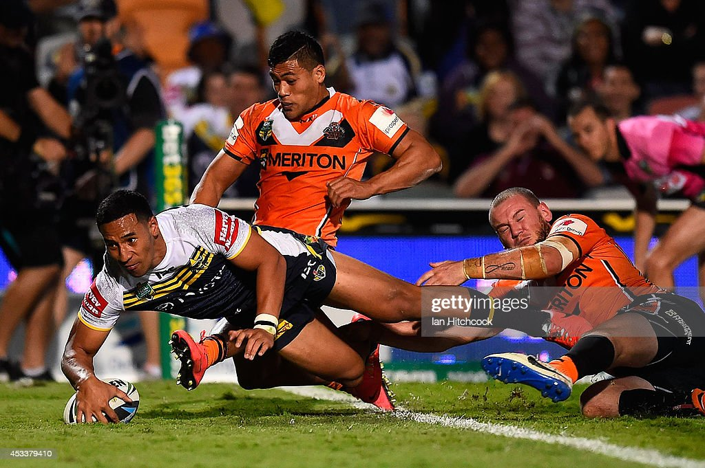 Tautau Moga of the Cowboys scores a try during the round 22 NRL match between the North Queensland Cowboys and the Wests Tigers at 1300SMILES Stadium on August 9, 2014 in Townsville, Australia.