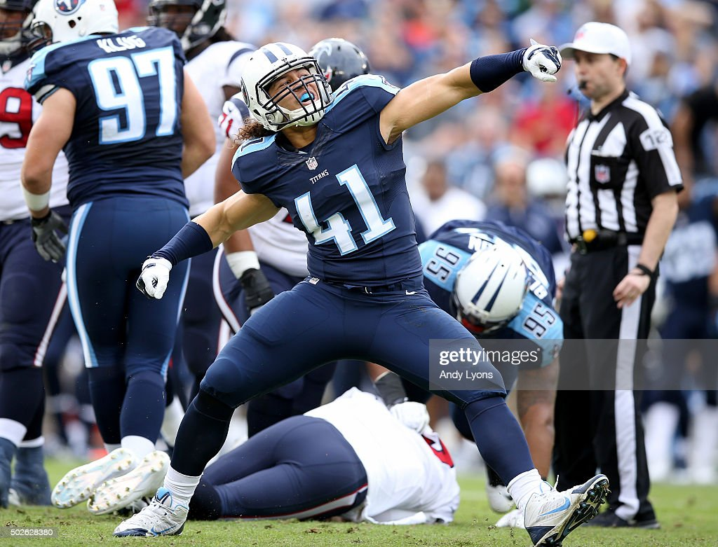 J.R. Tavai #41 of the Tennessee Titans celebrates during the game against the Houston Texans at LP Field on December 27, 2015 in Nashville, Tennessee.
