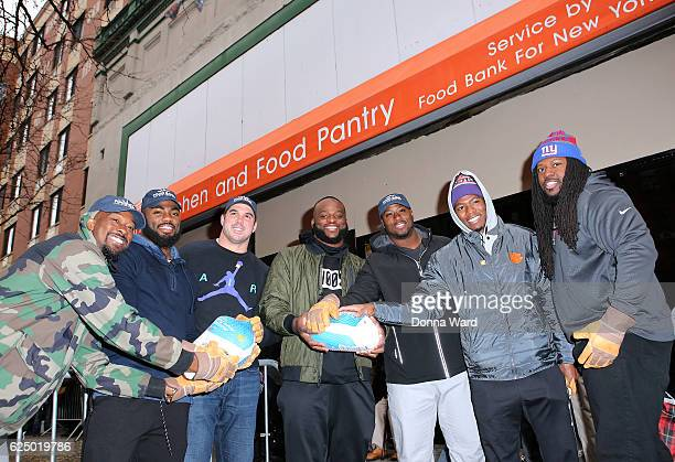 Tavares King Landon Collins Zak DeOssie Owa Odighdizuwa Will Johnson Coty Sensabaum and Adam Gettis appear to serve at Food Bank for New York City's...