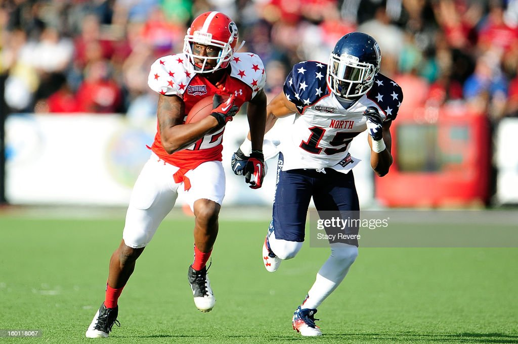 Tavarres King #12 of the South squad runs for yards in front of Blidi Wreh-Wilson #15 of the North squad during the first half of the Senior Bowl at Ladd Peebles Stadium on January 26, 2013 in Mobile, Alabama.