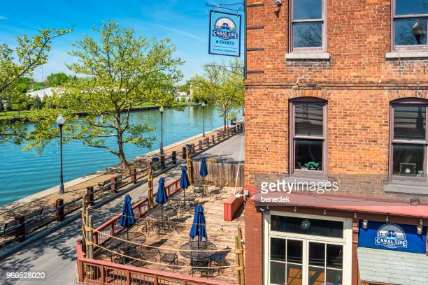 tavern and promenade in downtown seneca falls finger lakes region new york - finger lakes stock pictures, royalty-free photos & images