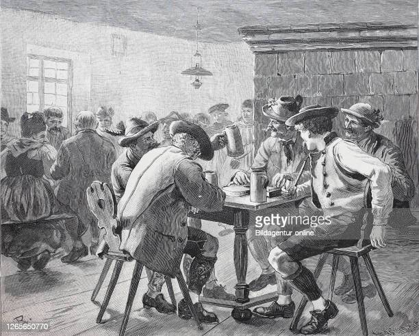 Tavern in Bavaria Germany men drinking beer / Wirtshaus in Bayern Deutschland Männer die Bier trinken Historisch digital improved reproduction of an...