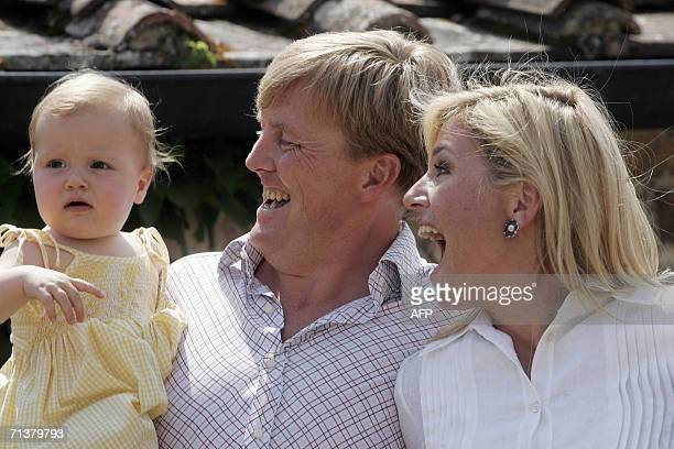 Dutch Prince WillemAlexander Princess Maxima and their daughter Alexia pose at their Italian holiday residence in Tavernelle 06 July 2006 AFP PHOTO /...