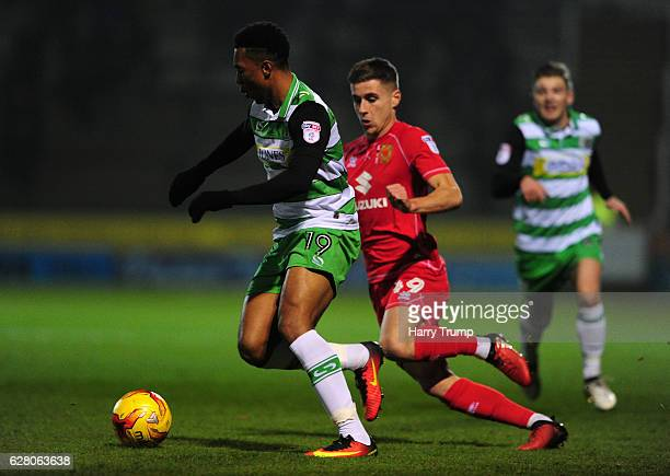 Tavhon Campbell of Yeovil Town is tackled by Ryan Colclough of MK Dons during the EFL Checkatrade Trophy Second Round match between Yeovil Town and...
