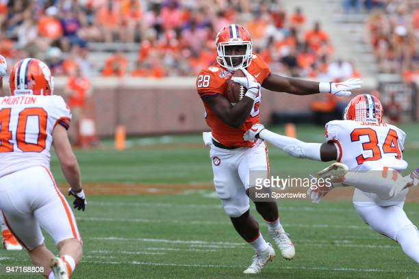 Tavien Feaster cuts back to make Kendall Joseph miss a tackle during action in the Clemson Spring Football game at Clemson Memorial Stadium on April...