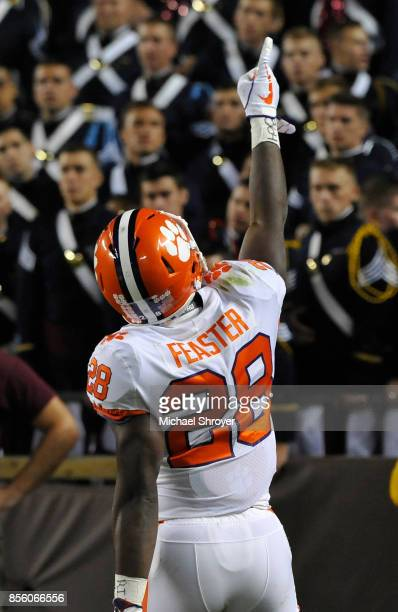 Tavien Feaster of the Clemson Tigers celebrates after scoring a 60yard touchdown during the first quarter against the Virginia Tech Hokies at Lane...
