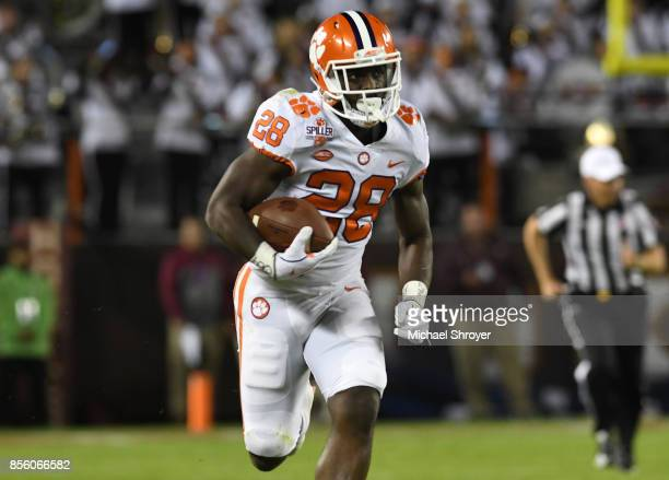 Tavien Feaster of the Clemson Tigers runs for a 60yard touchdown after catching a pass from quarterback Kelly Bryant during the first quarter against...