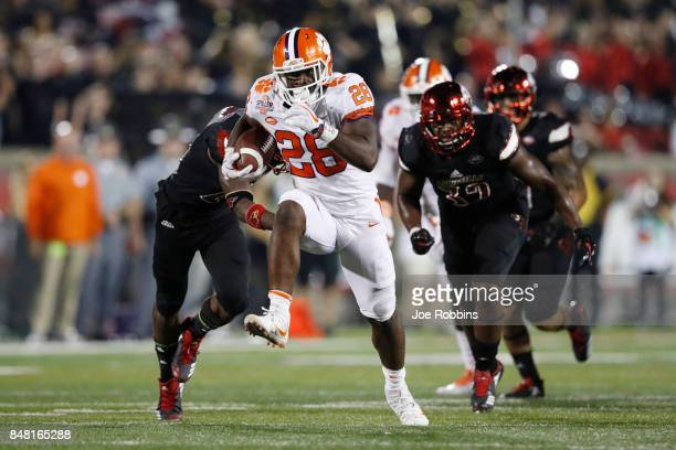 Tavien Feaster of the Clemson Tigers runs the ball in the third quarter of a game against the Louisville Cardinals at Papa John's Cardinal Stadium on...