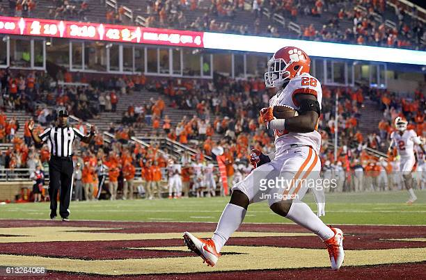 Tavien Feaster of the Clemson Tigers runs the ball in to the end zone for a touchdown in the fourth quarter against the Boston College Eagles at...