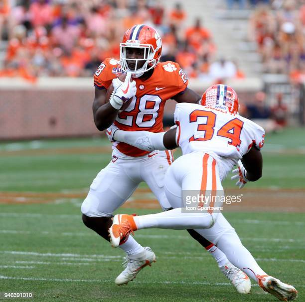 Tavien feaster side steps the tackle of Kendall Joseph during action in the Clemson Spring Football game on April 14 at Clemson Memorial Stadium in...