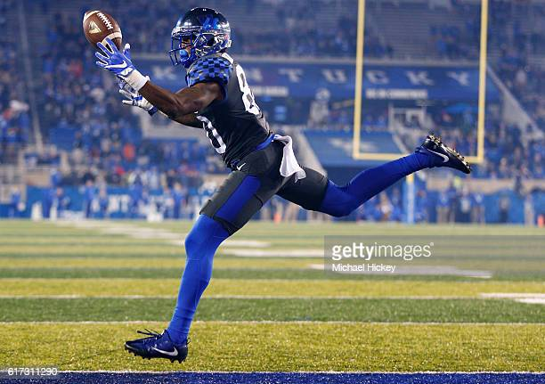 Tavin Richardson of the Kentucky Wildcats reaches for the ball to make the two point conversion during the game against the Mississippi State...