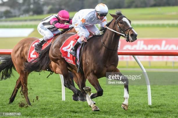 Tavisan ridden by Ben Melham wins the Le Pine Funerals Handicap at Ladbrokes Park Hillside Racecourse on July 10 2019 in Springvale Australia