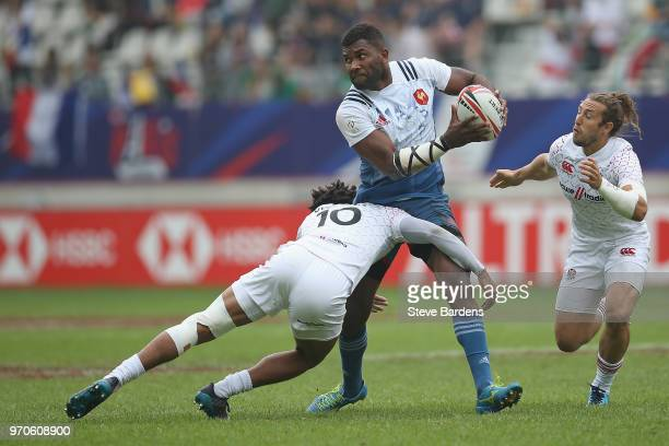 Tavite Veredamu of France is tackled by Ryan Olowofela of England during the pool match between England and Franc during the HSBC Paris Sevens at...