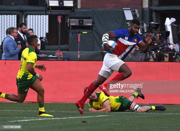 Tavite Veredamu of France runs to score the winning try against Australia during their men's round of 16 games at the Rugby Sevens World Cup in the...