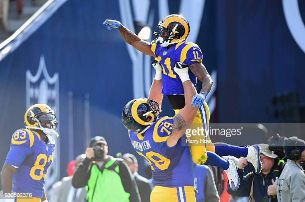 Tavon Austin celebrates with Robert Havenstein of the Los Angeles Rams after scoring a touchdown during the first quarter against the San Francisco...