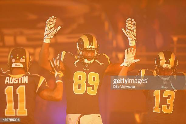 Tavon Austin Jared Cook Chris Givens of the St Louis Rams pay homage to Mike Brown by holding their hands up during their pregame introduction...