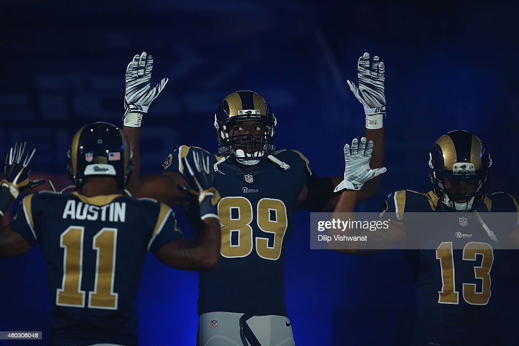 Tavon Austin #11, Jared Cook #89, Chris Givens #13 of the St. Louis Rams pay homage to Mike Brown by holding their hands up during their pre-game introduction against the Oakland Raiders at the Edward Jones Dome on November 30, 2014 in St. Louis, Missouri. The Rams beat the Raiders 52-0.