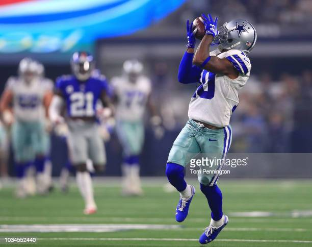 Tavon Austin of the Dallas Cowboys catches a pass he runs in for a touchdown in the first quarter of a football game against the New York Giants at...