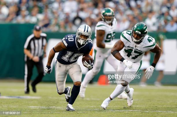 Tavon Austin of the Dallas Cowboys in action against Albert McClellan of the New York Jets at MetLife Stadium on October 13 2019 in East Rutherford...