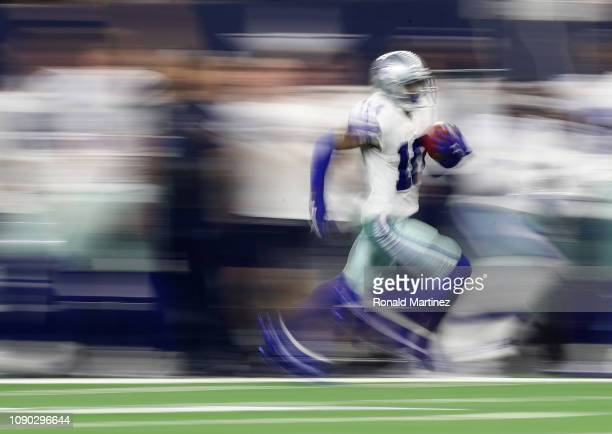Tavon Austin of the Dallas Cowboys runs the ball against the Seattle Seahawks in the first half during the Wild Card Round at ATT Stadium on January...
