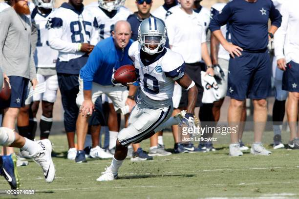 Tavon Austin of the Dallas Cowboys runs the ball during training camp at River Ridge Playing Fields on August 2 2018 in Oxnard California