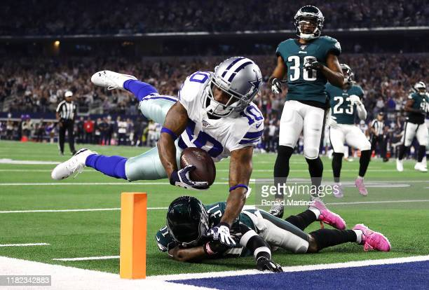 Tavon Austin of the Dallas Cowboys scores a 20-yard rushing touchdown during the first quarter against the Philadelphia Eagles in the game at AT&T...