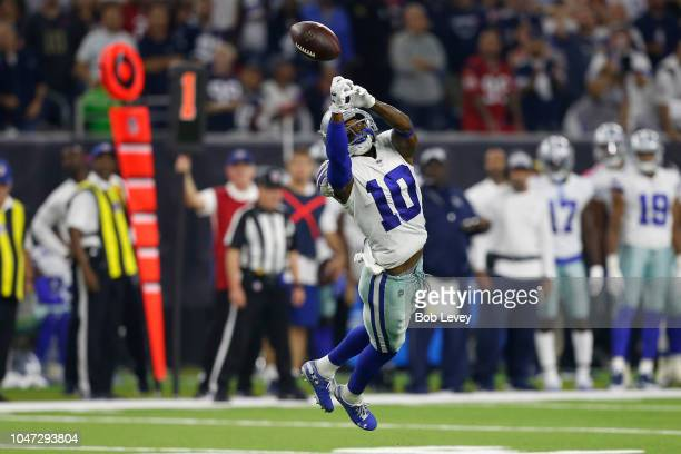 Tavon Austin of the Dallas Cowboys tips the ball away for an interception against the Houston Texans in the second quarter at NRG Stadium on October...