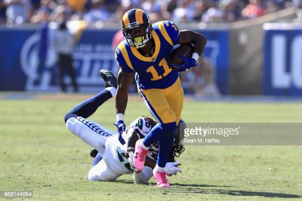 Tavon Austin of the Los Angeles Rams eludes Shaquill Griffin of the Seattle Seahawks during the second half of a game at Los Angeles Memorial...