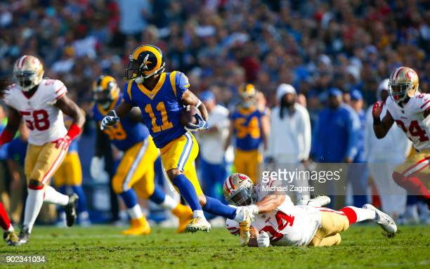 Tavon Austin of the Los Angeles Rams eludes Solomon Thomas of the San Francisco 49ers during the game at Los Angeles Memorial Coliseum on December 31...
