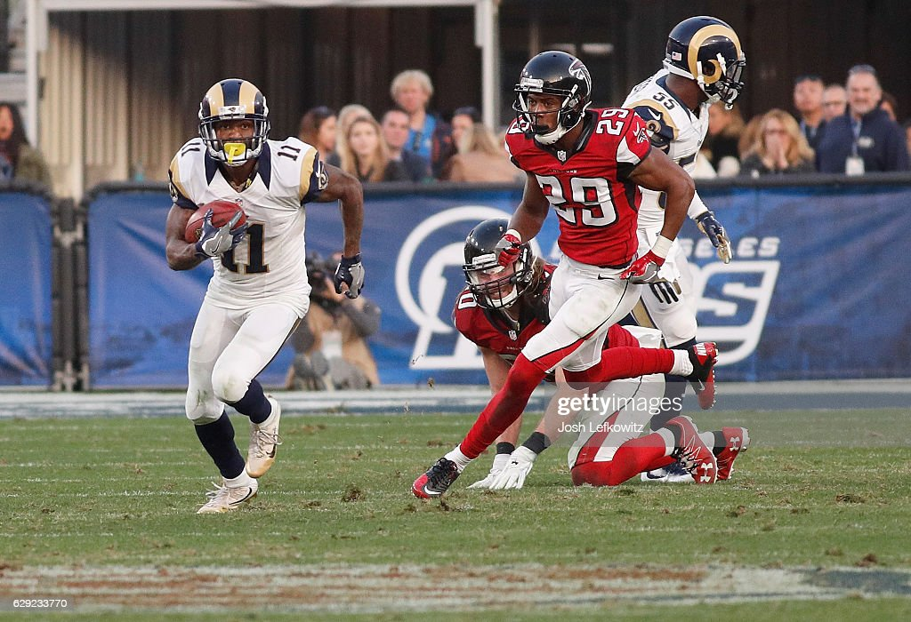 Tavon Austin #11 of the Los Angeles Rams runs the ball down field while being chased by C.J. Goodwin #29 of the Atlanta Falcons at the Los Angeles Memorial Coliseum on December 11, 2016 in Los Angeles, California.