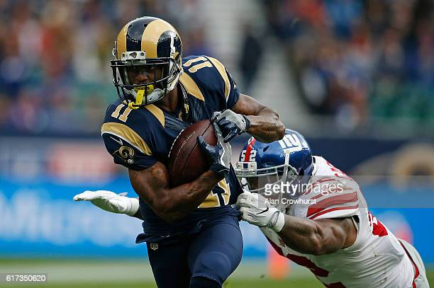 Tavon Austin of the Los Angeles Rams runs the ball during the NFL International Series match between New York Giants and Los Angeles Rams at...