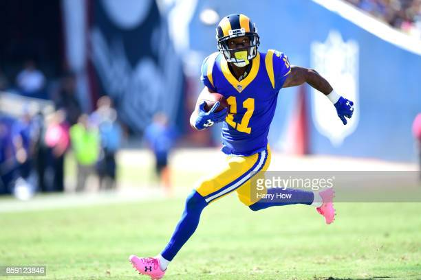 Tavon Austin of the Los Angeles Rams runs with the ball to make a touchdown during the game against the Seattle Seahawks at the Los Angeles Memorial...