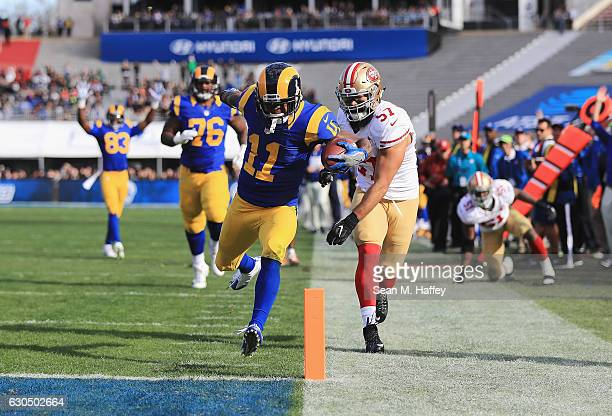 Tavon Austin of the Los Angeles Rams scores a touchdown during the first quarter against the San Francisco 49ers at Los Angeles Memorial Coliseum on...