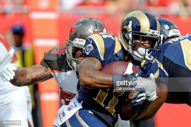 Tavon Austin of the St. Louis Rams rushes as Mason Foster of the Tampa Bay Buccaneers defends during the first half of the game at Raymond James...