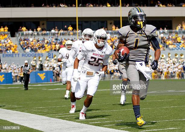 Tavon Austin of the West Virginia Mountaineers carries the ball for a touchdown in the first half against the Maryland Terrapins during the game on...