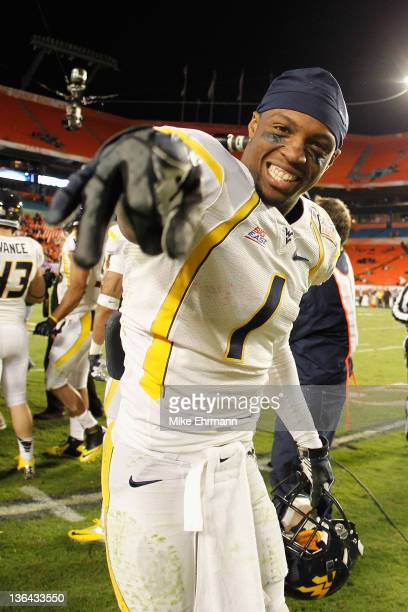 Tavon Austin of the West Virginia Mountaineers celebrates West Virginia's 70-33 win against the Clemson Tigers during the Discover Orange Bowl at Sun...