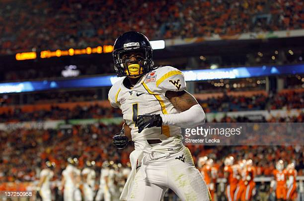 Tavon Austin of the West Virginia Mountaineers looks on after he scored a touchdown against the Clemson Tigers during the Discover Orange Bowl at Sun...