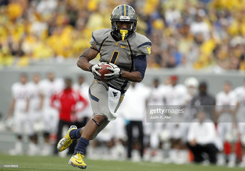 ... football jerseys  tavon austin 1 of the west virginia mountaineers runs  for a touchdown after a 34 704a88c6d