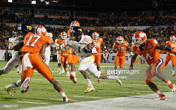 Tavon Austin of the West Virginia Mountaineers scores a27-yard touchdown reception in the second quarter against the Clemson Tigers during the...