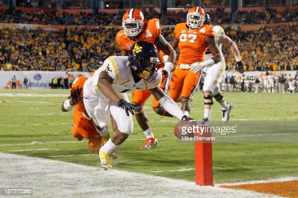 Tavon Austin of the West Virginia Mountaineers scores an 8yard rushing touchdown in the first quarter against the Clemson Tigers during the Discover...