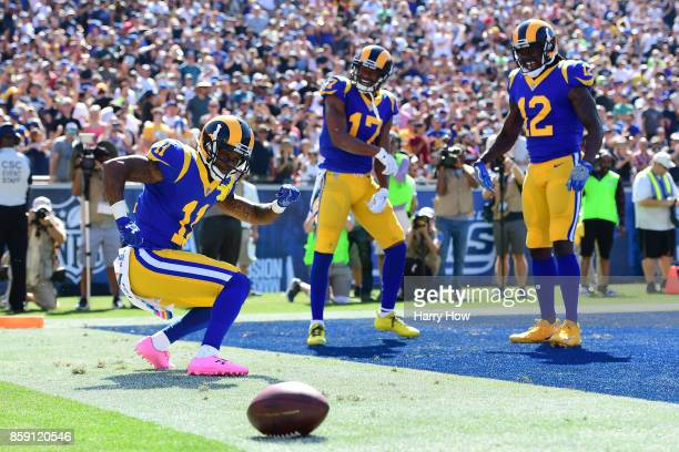 Tavon Austin Sammy Watkins and Robert Woods of the Los Angeles Rams celebrate after scoring a touchdown during the game against the Seattle Seahawks...