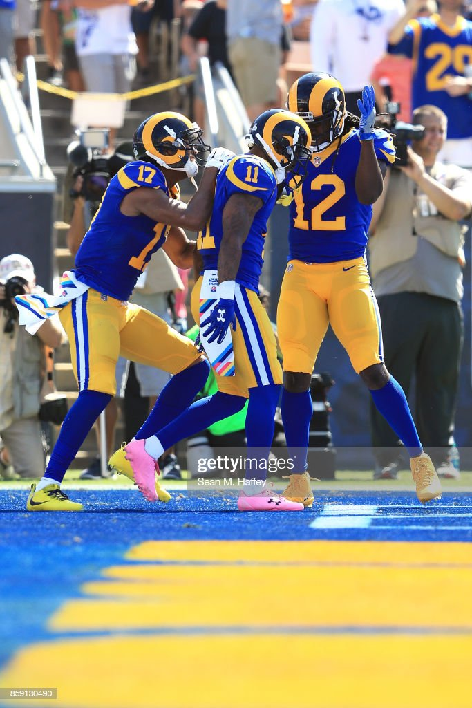 Tavon Austin #11, Sammy Watkins #12 and Robert Woods #17 of the Los Angeles Rams celebrate after a touchdown during the game against the Seattle Seahawks at the Los Angeles Memorial Coliseum on October 8, 2017 in Los Angeles, California.