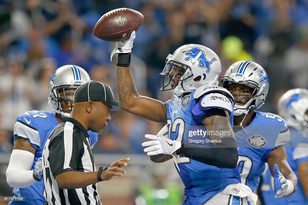 Tavon Wilson #32 of the Detroit Lions holds up the football after recovering a fumble in the end zone against the Washington Redskins during first half action at Ford Field on October 23, 2016 in Detroit, Michigan