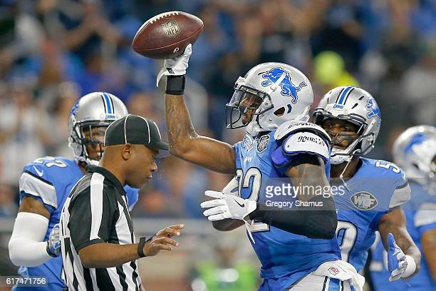 Tavon Wilson of the Detroit Lions holds up the football after recovering a fumble in the end zone against the Washington Redskins during first half...