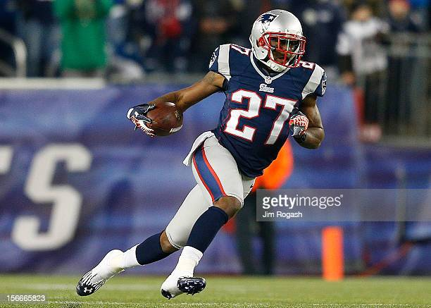 Tavon Wilson of the New England Patriots runs the ball after his interception in the second half against the Indianapolis Colts at Gillette Stadium...