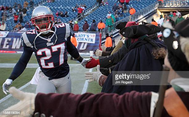Tavon Wilson of the New England Patriots shakes hands with the Endzone Militia before a game with the Miami Dolphins at Gillette Stadium on December...